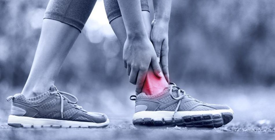bigstock-Broken-twisted-ankle--running-74368423.jpg